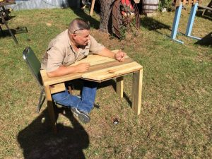 Adam Collette with a new rifle bench