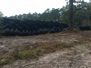 stacked tires as foundation for berm walls at range